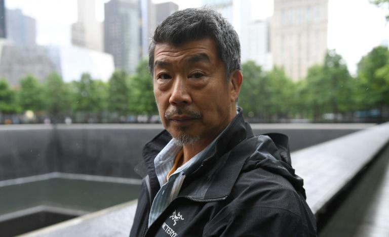 Al Kim, a paramedic who was almost killed when the South Tower collapsed, visits the 9/11 Memorial in New York
