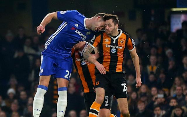 <p>Ryan Mason and Gary Cahill go for an aerial challenge </p>