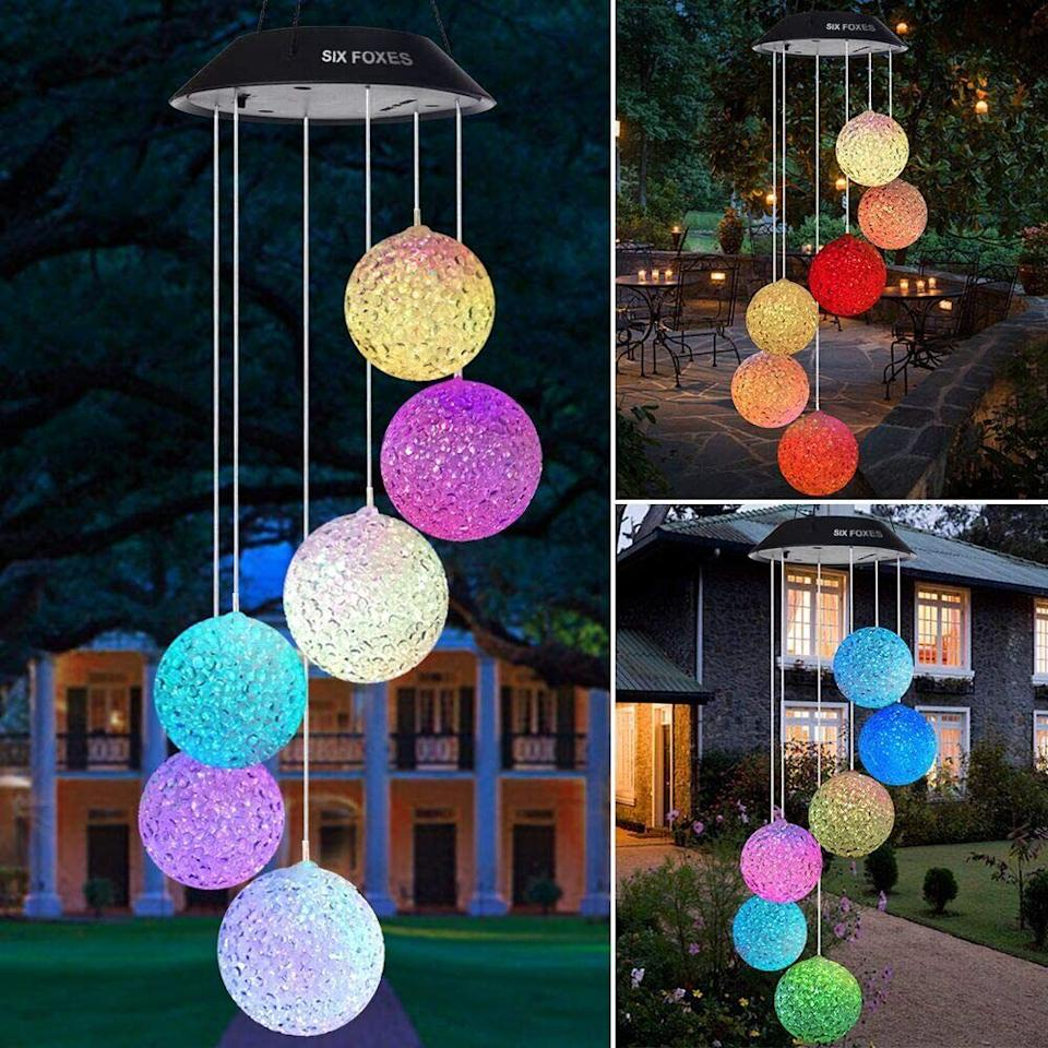 """Your porch will look like a colorful disco when it's nighttime.<br /><br /><strong>Promising review:</strong>""""When I first took this out of the box, I thought 'oh boy I don't know about this,' but I went ahead and hung it up outside to charge.<strong>When nighttime came, it started to light up and it is so neat. The colors gently change and none of them are muted.</strong>I am so happy with it."""" —<a href=""""https://amzn.to/3epY0xh"""" target=""""_blank"""" rel=""""nofollow noopener noreferrer"""" data-skimlinks-tracking=""""5580838"""" data-vars-affiliate=""""Amazon"""" data-vars-href=""""https://www.amazon.com/gp/customer-reviews/R3NP0N6W10Q2PY?tag=bfgenevieve-20&ascsubtag=5580838%2C30%2C33%2Cmobile_web%2C0%2C0%2C1159962"""" data-vars-keywords=""""cleaning,fast fashion"""" data-vars-link-id=""""1159962"""" data-vars-price="""""""" data-vars-product-id=""""16176946"""" data-vars-retailers=""""Amazon"""">Amazon Customer</a><br /><br /><strong>Get it from Amazon for<a href=""""https://amzn.to/32BBA6O"""" target=""""_blank"""" rel=""""nofollow noopener noreferrer"""" data-skimlinks-tracking=""""5580838"""" data-vars-affiliate=""""Amazon"""" data-vars-asin=""""B07P2JXD73"""" data-vars-href=""""https://www.amazon.com/dp/B07P2JXD73?tag=bfgenevieve-20&ascsubtag=5580838%2C30%2C33%2Cmobile_web%2C0%2C0%2C1159944"""" data-vars-keywords=""""cleaning,fast fashion"""" data-vars-link-id=""""1159944"""" data-vars-price="""""""" data-vars-product-id=""""7796634"""" data-vars-product-img=""""https://m.media-amazon.com/images/I/61G+HI-O+LL._SL500_.jpg"""" data-vars-product-title=""""YARD DECOR LIGHTED WIND CHIME"""" data-vars-retailers=""""Amazon"""">$21.99</a>.</strong>"""
