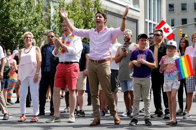 Canada's Prime Minister Justin Trudeau (C) takes part in the Ottawa Pride Parade with his daughter Ella-Grace (R), son Xavier (2nd R), Ottawa Mayor Jim Watson (2nd L) and Ontario Premier Kathleen Wynne (L) in Ottawa, Ontario, Canada, August 27, 2017. REUTERS/Chris Wattie