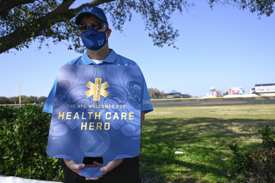 Sign reading, 'The NFL welcomes our health care hero.'