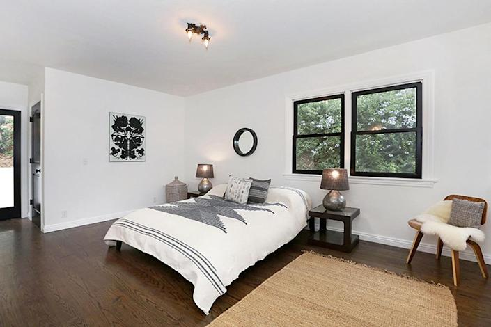 <p>Both refinished bedrooms are large enough to be the master suite. Both also connect to an outdoor patio.<i> (Photo: Charmaine David for Kenihan Development)</i><br></p>