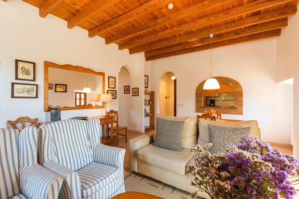 """<p>For an agroturismo (farm stay) experience, try <a href=""""https://go.redirectingat.com?id=127X1599956&url=https%3A%2F%2Fwww.booking.com%2Fhotel%2Fes%2Fsa-torre-de-santa-euga-nia.en-gb.html%3Faid%3D2070929%26label%3Dmallorca-hotels&sref=https%3A%2F%2Fwww.redonline.co.uk%2Ftravel%2Fg37570714%2Fmallorca-hotels%2F"""" rel=""""nofollow noopener"""" target=""""_blank"""" data-ylk=""""slk:Finca Sa Torre de Santa Eugenia"""" class=""""link rapid-noclick-resp"""">Finca Sa Torre de Santa Eugenia</a>, a country estate spread over 25 hectares that dates back to 1560, just outside the village of Santa Eugenia. Its location in the heart of the wine growing area isn't its only draw: Sa Torre manages to combine traditional Mallorcan lifestyle with modern day comforts in its six rooms and apartments.</p><p>The Cellar Sa Torre restaurant offers fine dining and a tasting menu with complimentary wines in the authentic setting of the estate's original wine cellar, which is lined by old aged wine barrels.Other features include two swimming pools with a sunbathing terrace, a lake and stunning Mediterranean gardens. </p><p><a class=""""link rapid-noclick-resp"""" href=""""https://go.redirectingat.com?id=127X1599956&url=https%3A%2F%2Fwww.booking.com%2Fhotel%2Fes%2Fsa-torre-de-santa-euga-nia.en-gb.html%3Faid%3D2070929%26label%3Dmallorca-hotels&sref=https%3A%2F%2Fwww.redonline.co.uk%2Ftravel%2Fg37570714%2Fmallorca-hotels%2F"""" rel=""""nofollow noopener"""" target=""""_blank"""" data-ylk=""""slk:CHECK AVAILABILITY"""">CHECK AVAILABILITY</a></p>"""