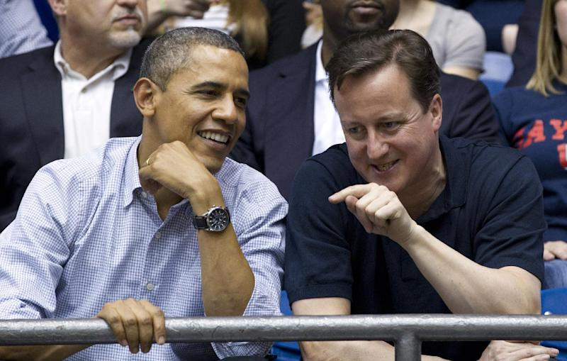 President Barack Obama and Britain's Prime Minister David Cameron attend the Mississippi Valley State versus Western Kentucky first round NCAA tournament basketball game, Tuesday, March 13, 2012, at University of Dayton Arena, in Dayton, Ohio. (AP Photo/Carolyn Kaster)