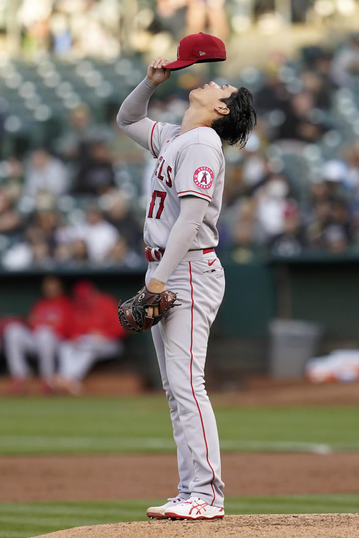 Los Angeles Angels pitcher Shohei Ohtani reacts after walking Oakland Athletics' Tony Kemp during the third inning of a baseball game in Oakland, Calif., Monday, July 19, 2021. (AP Photo/Jeff Chiu)