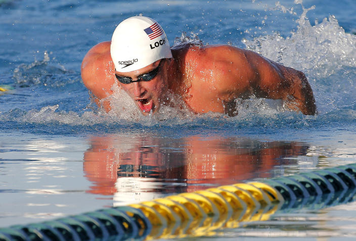 Ryan Lochte competes in the 100-meter butterfly final during the Arena Grand Prix swim meet, Thursday, April 24, 2014, in Mesa, Ariz. Lochte won, and Michael Phelps finished in second place. Phelps was competing for the first time since the 2012 London Olympics. (AP Photo/Matt York)