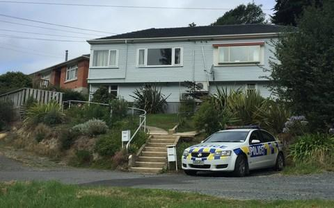 <span>Police remain outside a house on Sommerville St, Dunedin, associated with gunman Brenton Trent.</span> <span>Credit: Claire Drake </span>
