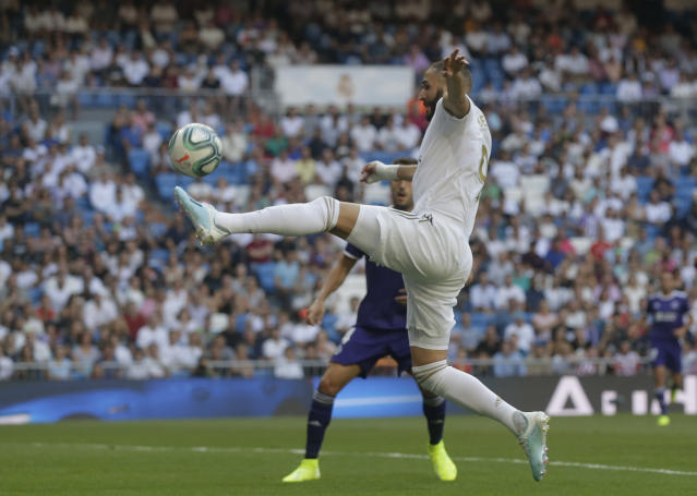 Real Madrid's Karim Benzema controls the ball during the Spanish La Liga soccer match between Real Madrid and Valladolid at the Santiago Bernabeu stadium in Madrid, Spain, Saturday, Aug. 24, 2019. (AP Photo/Paul White)