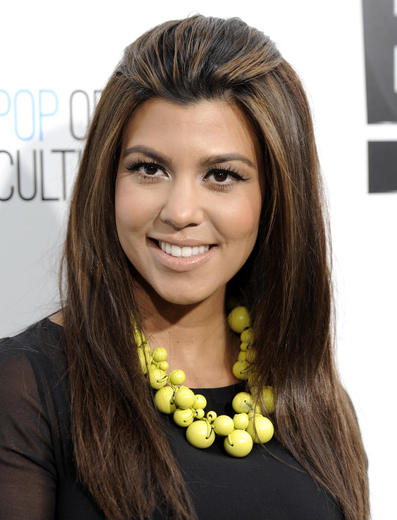 FILE - In an April 30, 2012 file photo Kourtney Kardashian  attends an E! Network upfront event at Gotham Hall in New York.  Kourtney Kardashian gave birth to a girl and she's naming  Penelope early Sunday July 8, 2012 at Cedars-Sinai Medical Center in Los Angeles.(AP Photo/Evan Agostini, file)