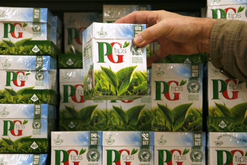 A shopper picks up a box of PG Tips tea bags at a supermarket in London February 6, 2008. REUTERS/Luke MacGregor