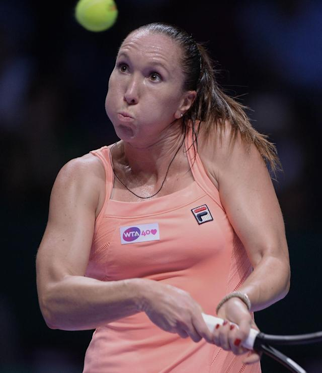 Jelena Jankovic of Serbia returns a shot to Victoria Azarenka of Belarus during their tennis match at the WTA championship in Istanbul, Turkey, Wednesday, Oct. 23, 2013. The world's top female tennis players compete in the championships which runs from Oct. 22 until Oct. 27.(AP Photo)