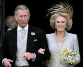 FILE - In this Saturday, April 9, 2005 file photo, Britain's Prince Charles and his bride Camilla Duchess of Cornwall leave St George's Chaple in Windsor, England following the church blessing of their civil wedding ceremony. Prince Philip was the longest serving royal consort in British history. In Britain, the husband or wife of the monarch is known as consort, a position that carries immense prestige but has no constitutional role. The wife of King George VI, who outlived him by 50 years, was loved as the Queen Mother. (AP Photo/ Alastair Grant, Pool, File)