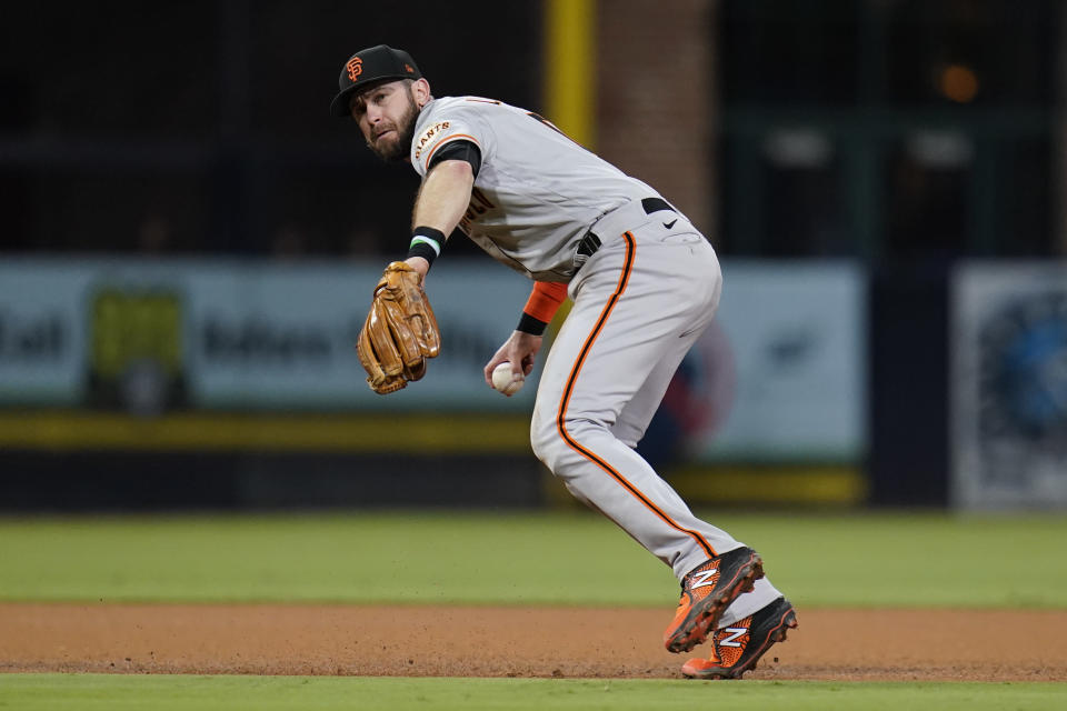 San Francisco Giants third baseman Evan Longoria throws to first for the out on San Diego Padres' Eric Hosmer during the fourth inning of a baseball game Wednesday, Sept. 22, 2021, in San Diego. (AP Photo/Gregory Bull)