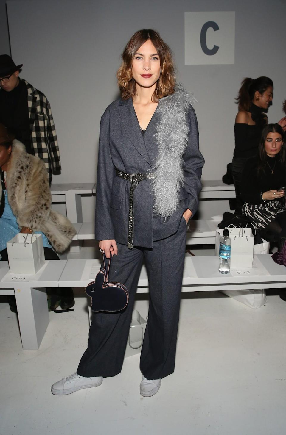 <p>Alexa Chung belted up in a loose-fitting suit. <i>[Photo: Getty]</i> </p>