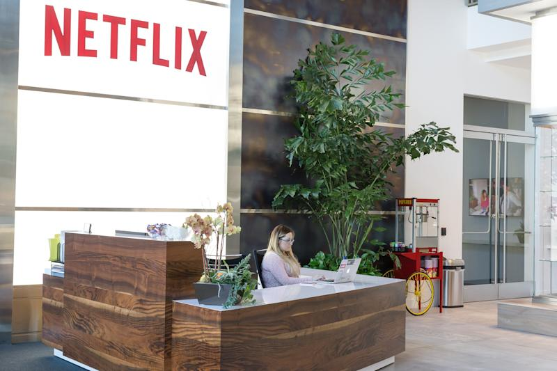 A receptionist sitting at a desk in the Netflix headquarters lobby.