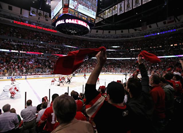CHICAGO, IL - MAY 15: Fans cheer after Patrick Sharp of the Chicago Blackhawks scored an empty-net goal against the Detroit Red Wings in Game One of the Western Conference Semifinals during the 2013 NHL Stanley Cup Playoffs at the United Center on May 15, 2013 in Chicago, Illinois. The Blackhawks defeated the Red Wings 4-1. (Photo by Jonathan Daniel/Getty Images)