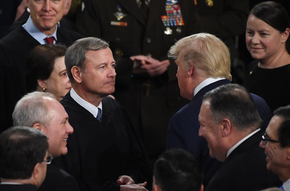 Donald Trump greets Supreme Court Chief Justice John Roberts as the president arrives to deliver the State of the Union address on Feb. 4, 2020. Trump's promise to name conservative judges secured his support from Republican leaders in 2016. (Photo: OLIVIER DOULIERY/AFP via Getty Images)