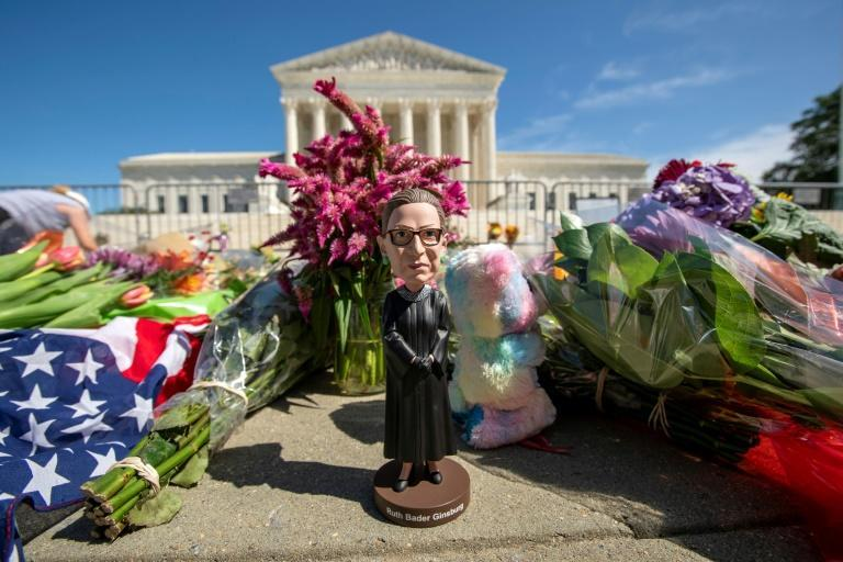 A bobblehead of US Supreme Court Justice Ruth Bader Ginsburg is left outside of the US Supreme Court in Washington, DC, on September 19, 2020 to honor her death