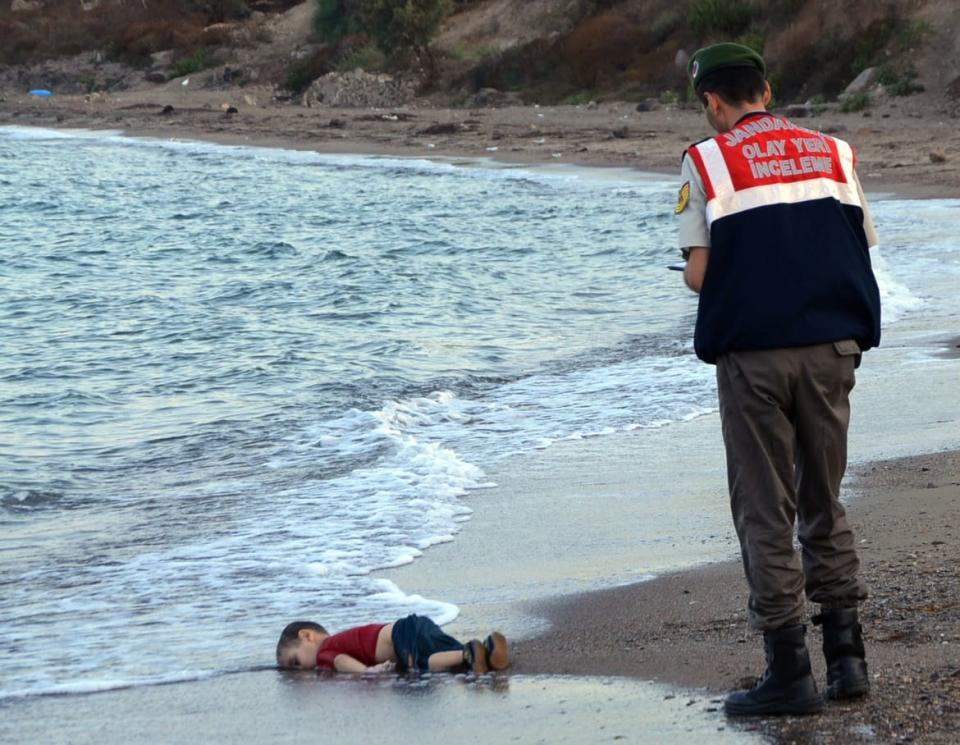 "<div class=""inline-image__caption""><p>A paramilitary police officer investigated the scene before carrying the body of 3-year-old Syrian refugee Aylan Kurdi from the sea shore, near the beach resort of Bodrum, Turkey, on Sept. 2, 2015.</p></div> <div class=""inline-image__credit"">Nilufer Demir/DHA via AP</div>"