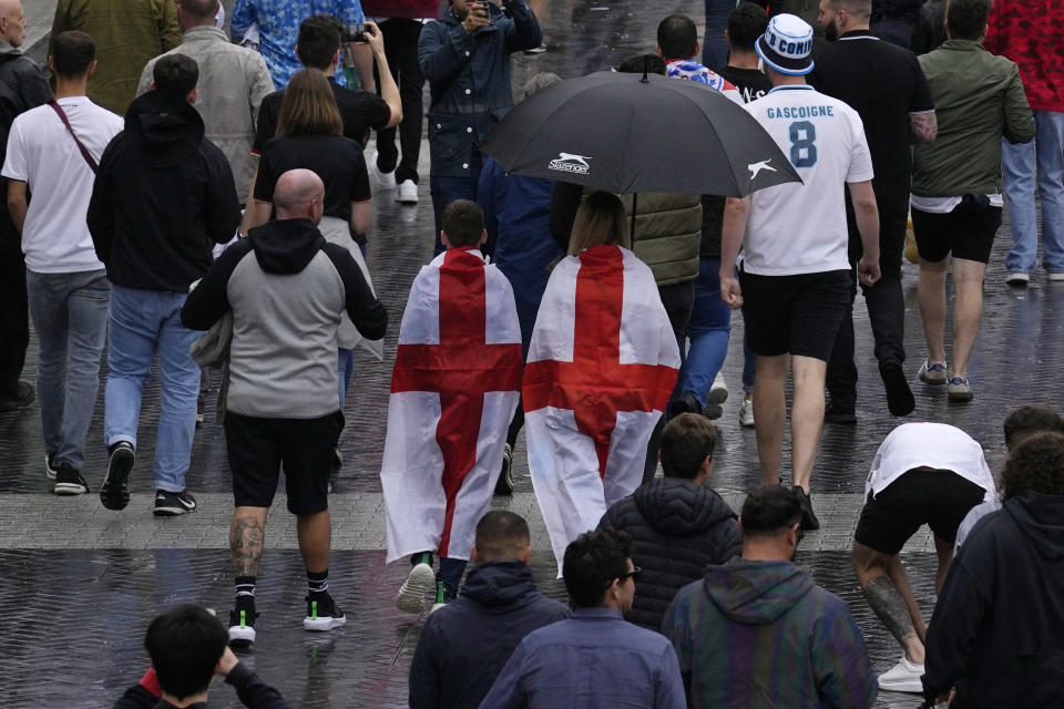 England supporters make their way to Wembley Stadium in London, Tuesday, June 29, 2021 as they arrive for the Euro 2020 soccer championship round of 16 match between England and Germany. (AP Photo/Matt Dunham)