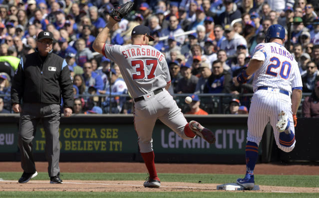 New York Mets' Pete Alonso (20) is safe at first as Washington Nationals pitcher Stephen Strasburg (37) drops the ball covering first base during the first inning of a baseball game Thursday, April 4, 2019, in New York. Strasburg was charged with an error on the play. (AP Photo/Bill Kostroun)