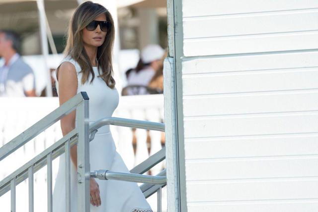 """<p>Melania paired a fitted white dress with oversized sunglasses at the Women's Open Golf Championship at <a href=""""http://www.townandcountrymag.com/leisure/travel-guide/g9542605/trump-national-bedminster-things-to-know/"""" rel=""""nofollow noopener"""" target=""""_blank"""" data-ylk=""""slk:Trump National Golf Course in Bedminster"""" class=""""link rapid-noclick-resp"""">Trump National Golf Course in Bedminster</a> over the weekend. At this point, Trump has visited his family's business properties more than 50 times over the course of his presidency.</p>"""