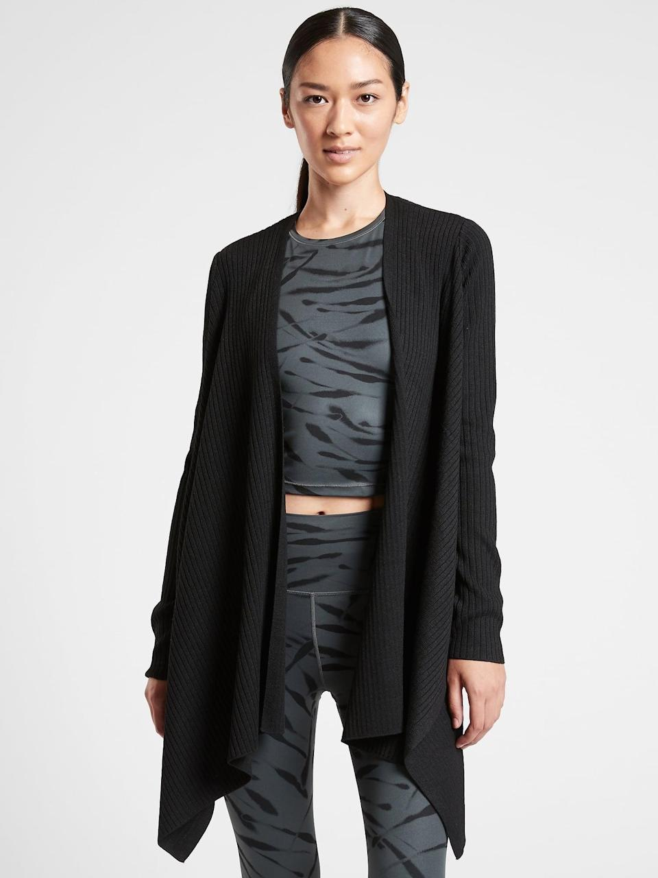 <p>Throwing on this comfy wool <span>Athleta Solstice Wrap</span> ($97, originally $129) will feel like a hug from you!</p>