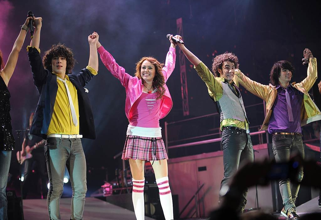 "By October 2007, Miley was ready to hit the road -- with the JoBros as one of her opening acts! The twangy-voiced celeb headlined a tour that parents were willing to fork over serious cash to bring their kids to see. Some fans reportedly paid more than $2,500! ""It's going to be a good show, but I don't think it's worth what it's going for,"" Miley said on ""The Ellen DeGeneres Show."" ""For the people that do get to come, I'm going to make it the best show ever."" Kevin Mazur/<a href=""http://www.wireimage.com"" target=""new"">WireImage.com</a> - December 27, 2007"