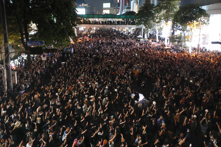 Pro-democracy protesters flash the three-finger protest salute during an anti-government rally in Bangkok, Thailand, Wednesday, Nov. 18, 2020. Police in Thailand's capital braced for possible trouble Wednesday, a day after a protest outside Parliament by pro-democracy demonstrators was marred by violence that left dozens of people injured. (AP Photo/Sakchai Lalit)
