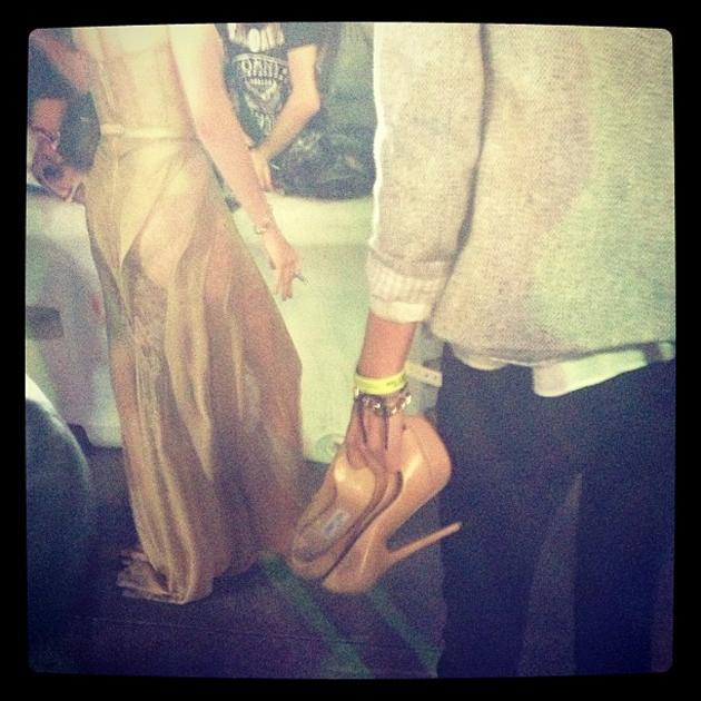 Kristen always comes with comfy she's, and someone to hold her #redcarpet shoes #breakingdawnlive