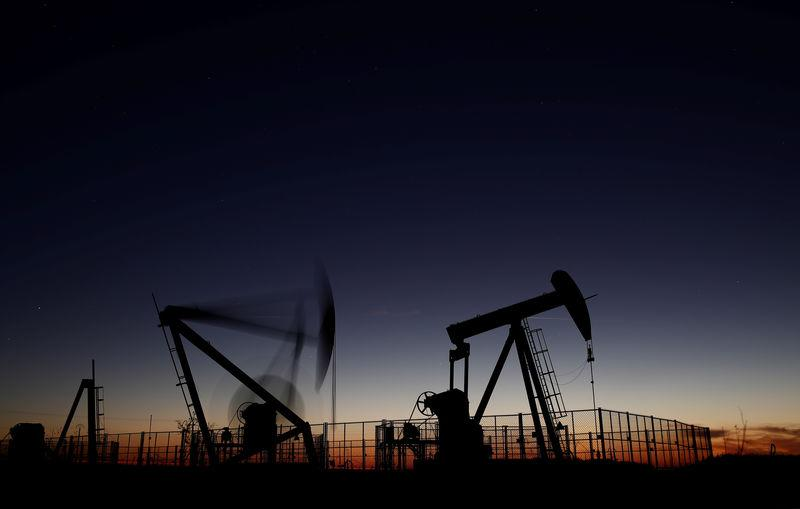 FILE PHOTO: Oil pumps are seen after sunset outside Vaudoy-en-Brie