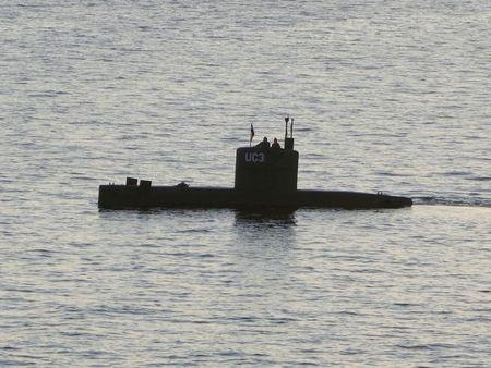 """FILE PHOTO: The home-made submarine """"UC3 Nautilus"""", built by Danish inventor Peter Madsen, who is charged with killing Swedish journalist Kim Wall in his submarine, sails in the harbour of Copenhagen, Denmark, August 10, 2017.   REUTERS/Peter Thompson"""