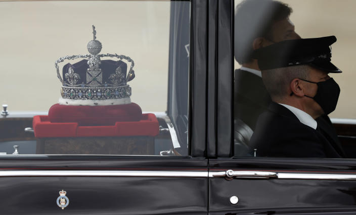 The Imperial State Crown is taken to the Palace of Westminster in London for the State Opening of Parliament, Tuesday May 11, 2021. (AP Photo/Alastair Grant)