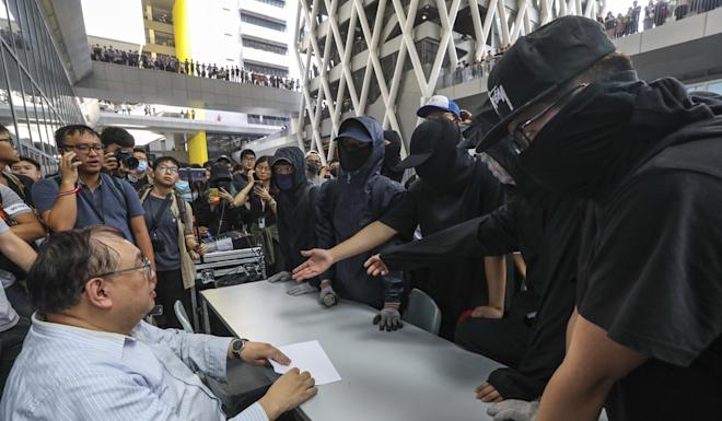 Dr Leung Hing-pong, an academic director at the design institute in Tseung Kwan O, is confronted with demands to release school footage showing the movements of a girl before her death. Photo: Dickson Lee