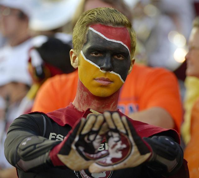 A Florida State fan cheers before the NCAA BCS National Championship college football game against Auburn Monday, Jan. 6, 2014, in Pasadena, Calif. (AP Photo/Mark J. Terrill)
