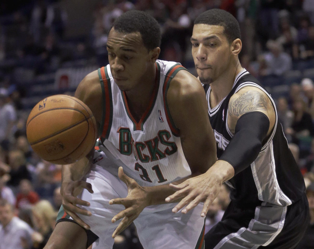 Milwaukee Bucks' John Henson(31) and San Antonio Spurs' Danny Green go after a loose ball during the first half of an NBA basketball game Wednesday, Dec. 11, 2013, in Milwaukee. (AP Photo/Morry Gash)