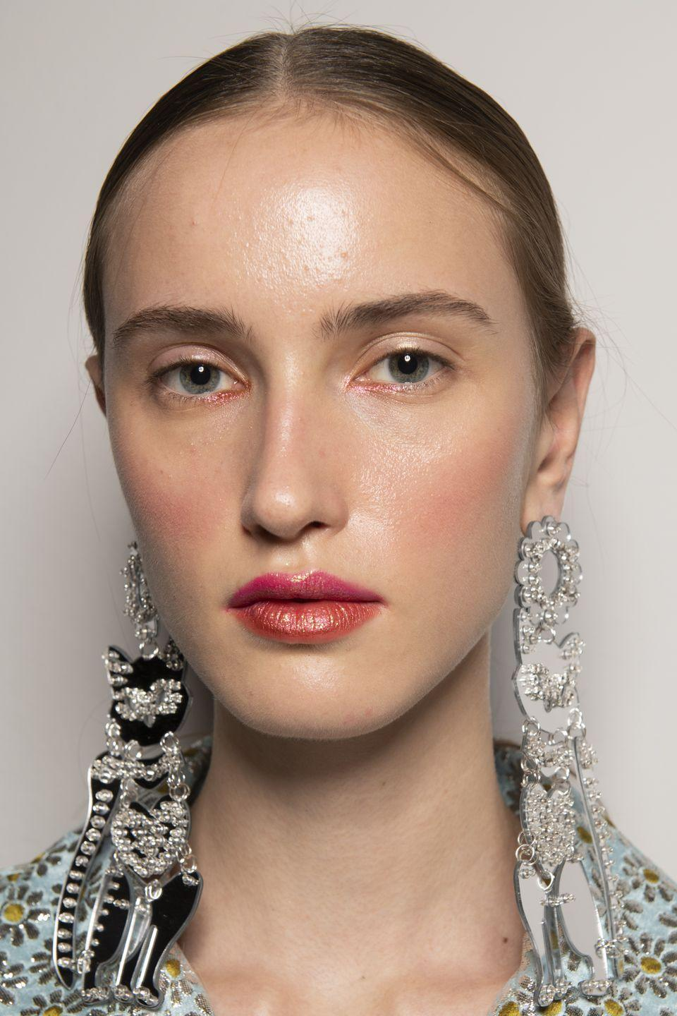 <p>Eschew the traditional red lip for a more offbeat mismatched combo of pink and orange.</p>
