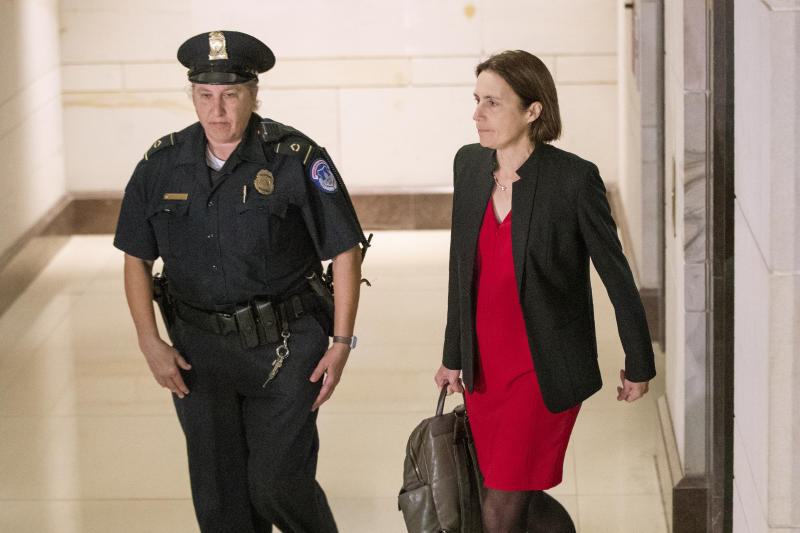 Former White House advisor on Russia, Fiona Hill, arrives on Capitol Hill in Washington, Monday, Oct. 14, 2019, as she is scheduled to testify before congressional lawmakers as part of the House impeachment inquiry into President Donald Trump.  (AP Photo/Manuel Balce Ceneta)