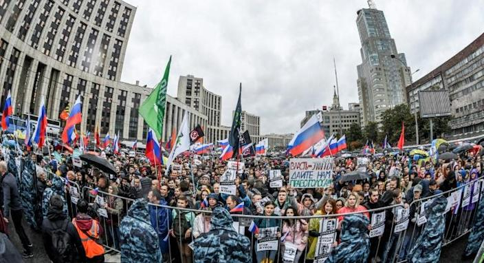 Tens of thousands took to the streets of Moscow after authorities refused to allow prominent opposition candidates to stand for the city parliament in September 8 elections (AFP Photo/Yuri KADOBNOV)