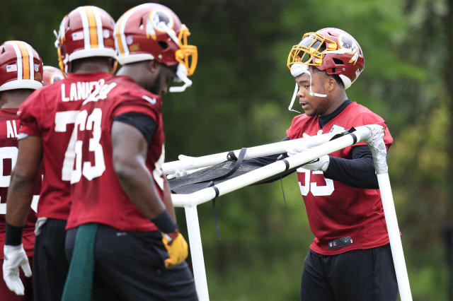 Redskins defensive guard Daron Payne, right, move equipment, during the NFL football team's full practice session at the Redskins Park in Ashburn, Va., Wednesday, May 30, 2018. (AP Photo/Manuel Balce Ceneta)