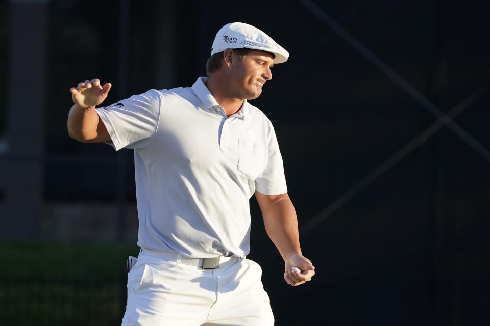 Bryson DeChambeau reacts after missing a putt on the 16th green during the final round of the Arnold Palmer Invitational golf tournament Sunday, March 7, 2021, in Orlando, Fla. (AP Photo/John Raoux)