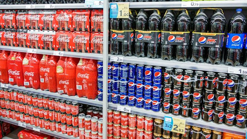 Coca-Cola and Pepsi bottles and cans