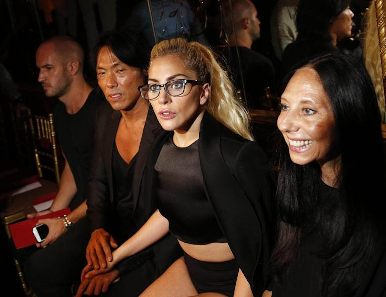 Lady Gaga, second from right, poses for pictures before the Brandon Maxwell Spring 2017 collection is modeled during Fashion Week at the Russian Tea Room in New York, Tuesday, Sept. 13, 2016. (AP Photo/Seth Wenig)