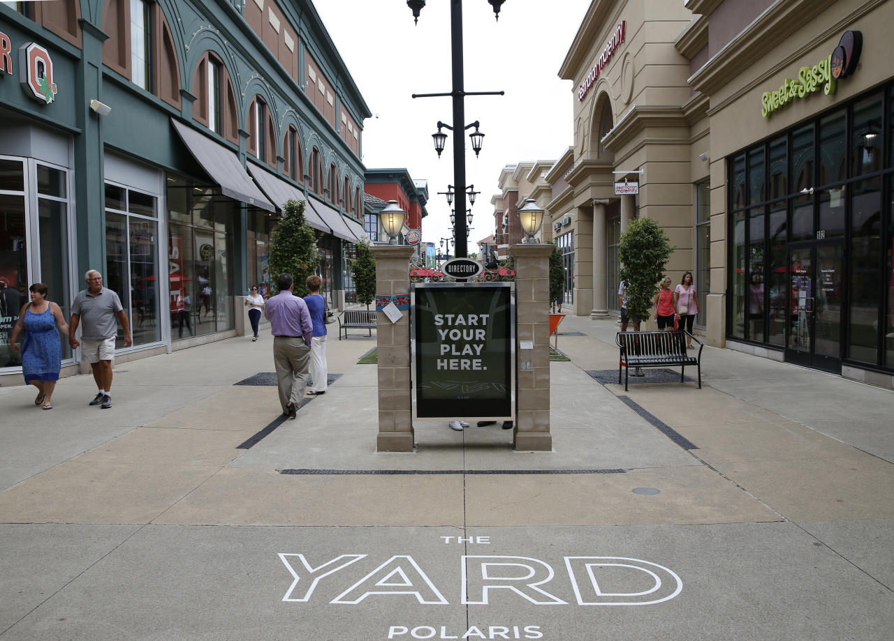 IMAGE DISTRIBUTED FOR WASHINGTON PRIME GROUP - Shoppers walk through The Yard at Polaris Fashion Place Sunday, July 15, 2018 in Columbus, Ohio. The Yard is Polaris Fashion Place's newest community gathering place where people can enjoy outdoor games while shopping and dining. (Jay LaPrete/AP Images for Washington Prime Group)