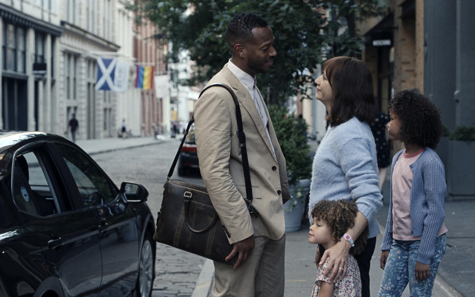 """This image released by Apple shows Marlon Wayans, left, Rashida Jones, Alexandra Mary Reimer, foreground, and Liyanna Muscat, right, in a scene from """"On the Rocks."""" (JoJo Whilden/Apple via AP)"""