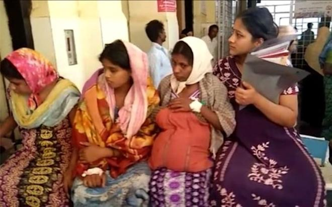 Four women on a stretcher in Karnataka