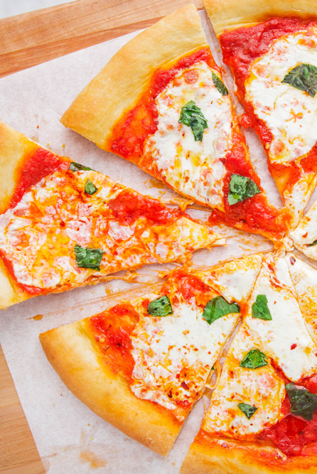 """<p>Nothing beats a fresh-out-of-the-oven pizza, and once you see how easy it is to make for yourself, you'll never order delivery again. Switch up the toppings and add your favourites to make it your own. Pepperoni, mushrooms, bell peppers, pineapple? You can have it all! </p><p>Get the <a href=""""https://www.delish.com/uk/cooking/recipes/a30686833/homemade-pizza-recipe/"""" rel=""""nofollow noopener"""" target=""""_blank"""" data-ylk=""""slk:Homemade Pizza"""" class=""""link rapid-noclick-resp"""">Homemade Pizza</a> recipe.</p>"""