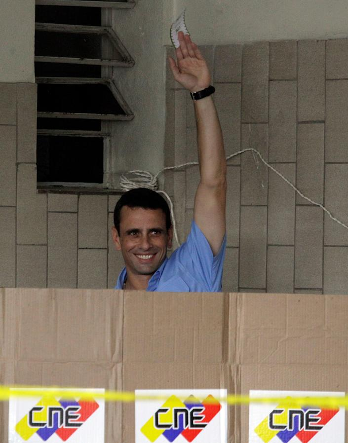 Miranda's Gov. Henrique Capriles holds up his ballot at a polling station in Caracas, Venezuela, Sunday, Dec. 16, 2012. Venezuelans are choosing governors and state lawmakers in elections that have become a key test of whether President Hugo Chavez's movement can endure if the socialist leader leaves the political stage. (AP Photo/Fernando Llano)
