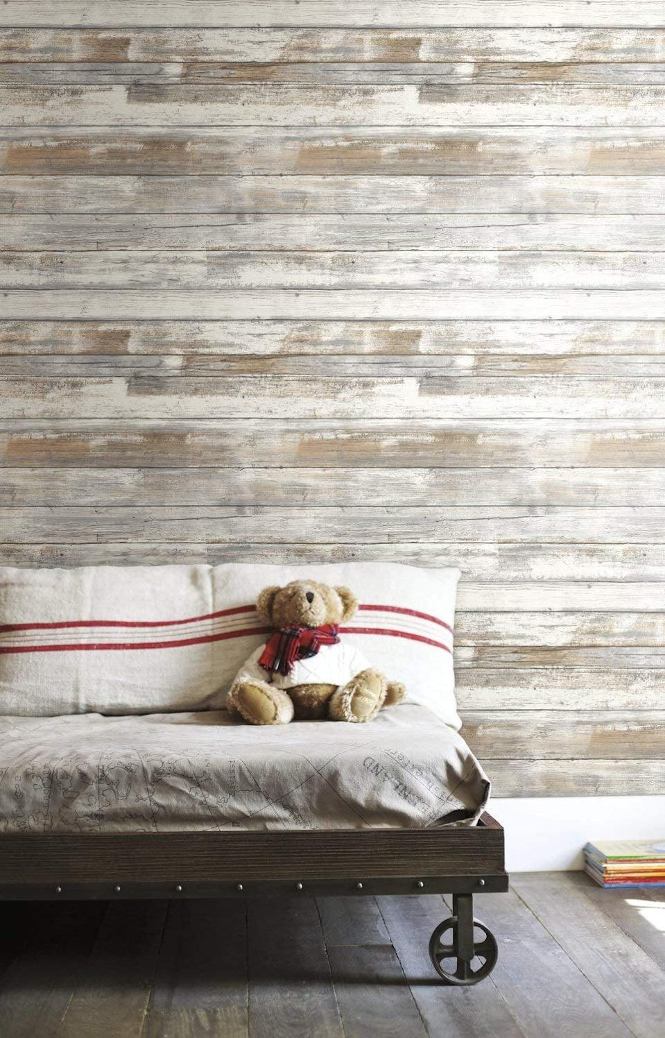 <p>If you've dreamed of having a wood-paneled room, grab this <span>RoomMates Distressed Wood Peel and Stick Wallpaper</span> ($26, originally $35).</p>
