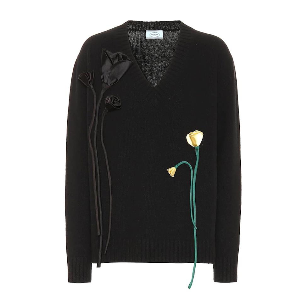 "<p>For the Prada-philes out there, you'll love the brand's take on the classic black V neck cashmere sweater. Adorned with handmade black and yellow flowers sprouting on either side, Prada breathes new life to the romantic floral trend, too.</p> <p><strong>Buy now:</strong> Prada, $2,480, <a href=""https://www.mytheresa.com/en-us/prada-appliqued-wool-and-cashmere-sweater-1297035.html?catref=category"">mytheresa.com</a>.</p>"